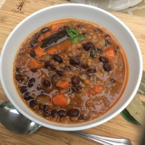 Hearty lentil and black bean soup with carrots.